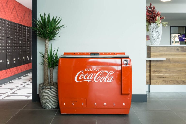 coca cola refreshement station in leasing office at the red apartments