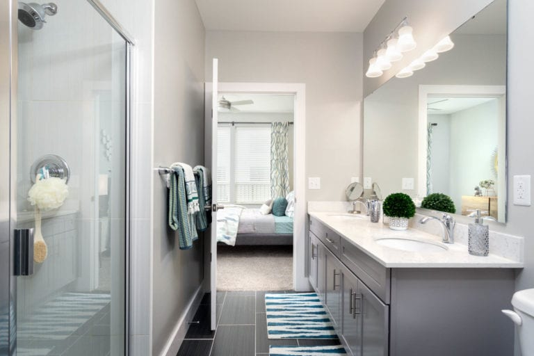 well-lit master bathroom with walk-in shower at the RED Apartments in Cincinnati