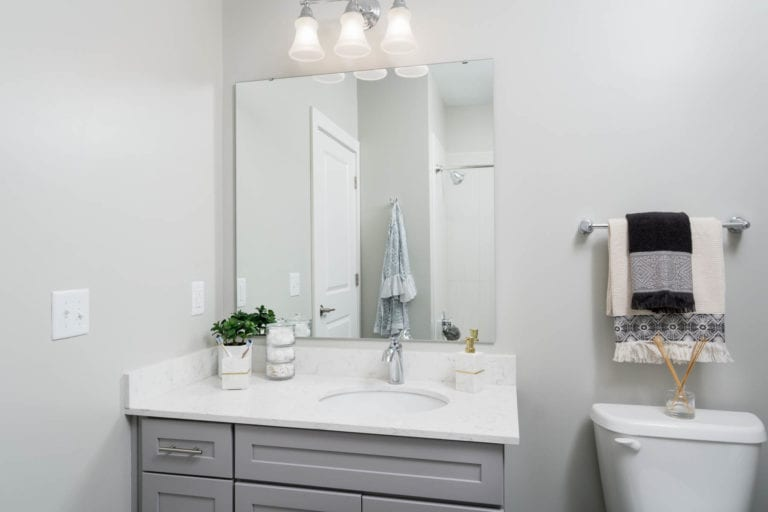 modern bathrooms with updated lighting at the RED Apartments
