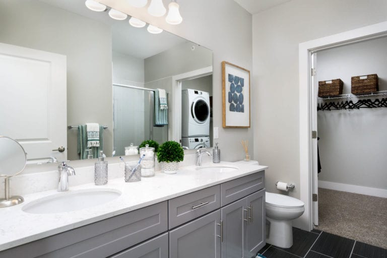spacious luxury bathroom with attached walk-in closets | theRED Apartments