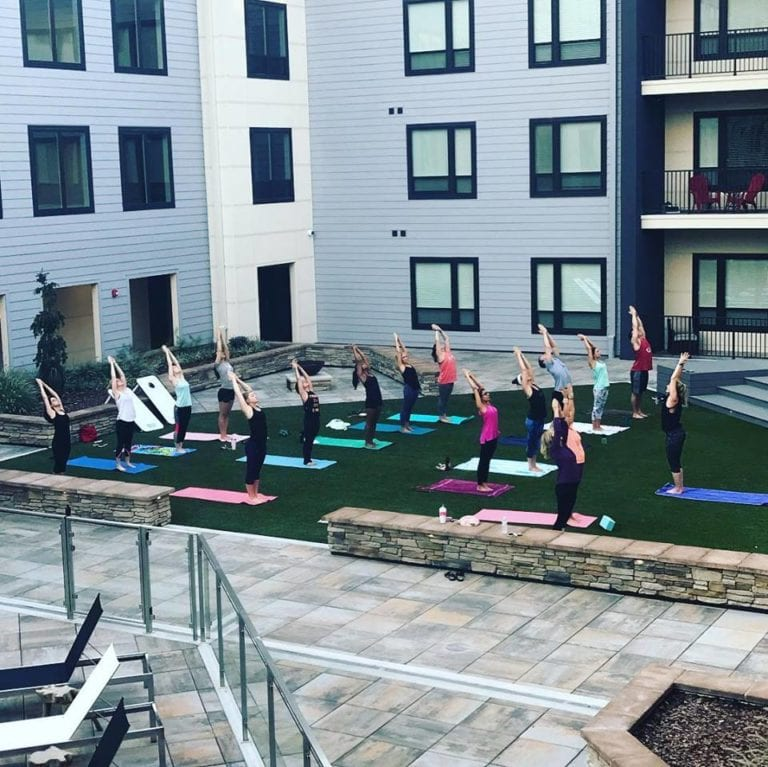 theRED Apartments Yoga lawn